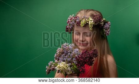 Happy Inexperienced Wonderful In A Lilac Wreath With A Beautiful Smile With A Bunch Of Flowers, With