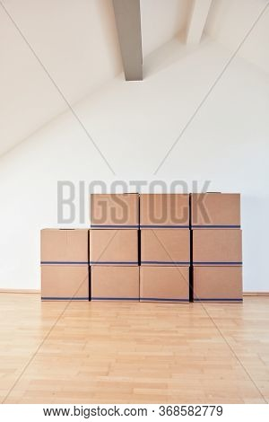 Moving boxes on wall in a bright apartment or office after moving in