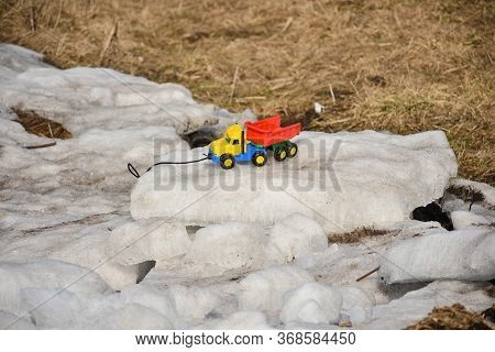 Plastic Toy Car On Ice, Toy On Ice, Multi-colored Toy Car, Bright Toy Car