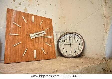 Round And Square Clocks Against The Wall, Two Clock Dials, Clock Dial, Many Wall Clocks, Two Old Wat
