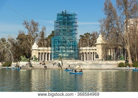 Madrid, Spain - January 22, 2018: Large Pond Of The Retiro And Monument To Alfonso Xii In The Retiro