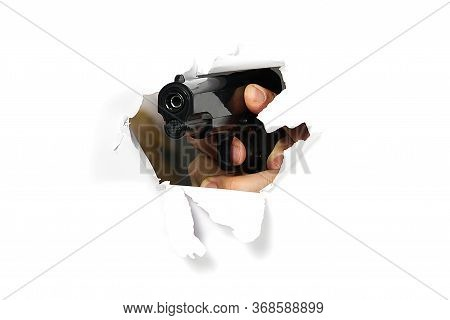 Mens Hand With A Gun. Crime Concept. Mans Hand Holding A Black Pistol Gun, Isolated On White, Close-