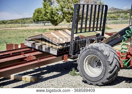 Fork Lift On Gravel Driveway Moving Steel Building Supplies On A Pallet
