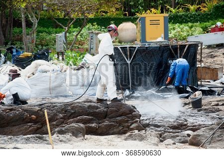 Rayong,thailand-february 8,2013 : Unidentified Workers And Volunteers Are Spraying Chemicals Onto Cr