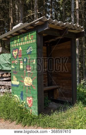 Bus Stop Painted By Children At The Edge Of The Forest - Wooden Hut And Waiting House