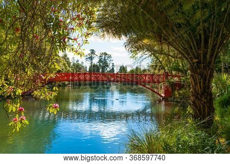Red Chinese Style Poets Bridge At Pukekura Park, New Plymouth New Zealand.