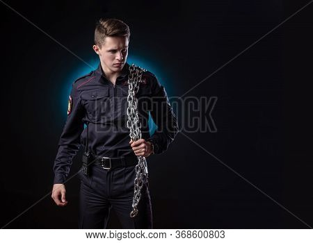 A Handsome Guy In A Police Uniform With A Big Chain On His Shoulder. Prison Warden. English Translat