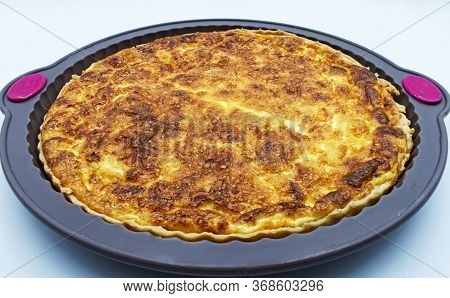 Baked Quiche Lorraine In The Mold Isolated On White Background