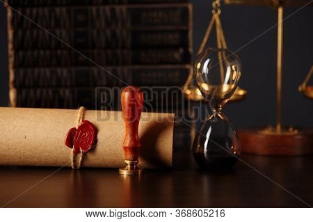 Wooden Gavel, Hourglass, Books And Stamp On Testament And Last Will In Notary Office. Notary Public