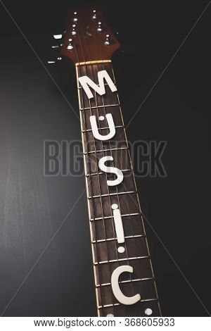 Detail Of Classic Guitar With Shallow Depth Of Field. Closeup Image Of Acoustic Guitar Fingerboard,