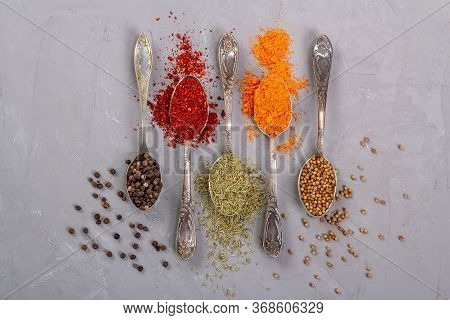 Dry Of Different Colors In Teaspoons. Top View