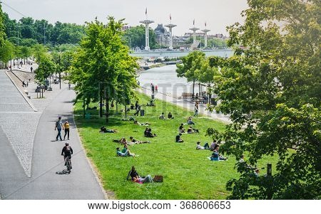 Lyon France, 16 May 2020 : People Doing Outdoor Activities On Rhone River Bank  On The First Weekend