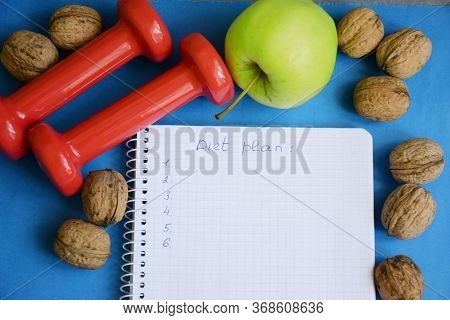 Diet Plan, Dumbbells And Diet Food From Fresh Fruits On The Background, Weight Loss And Diet Concept