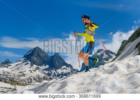 Practice Skyrunning At High Altitude On The Snow During The Descent.,