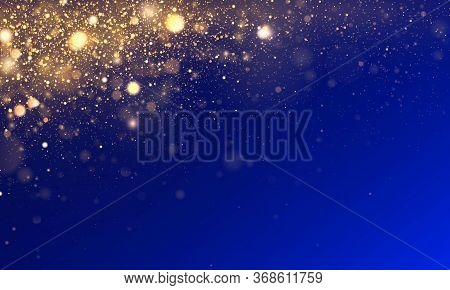Bokeh Effect. Blue Texture Glitter And Elegant For Christmas. Sparkling Magical Gold Yellow Dust Par