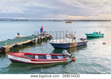 San Juan, Puerto Rico - April 30, 2019: Fishing Boats Moored Near The Shore Of San Juan, Puerto Rico