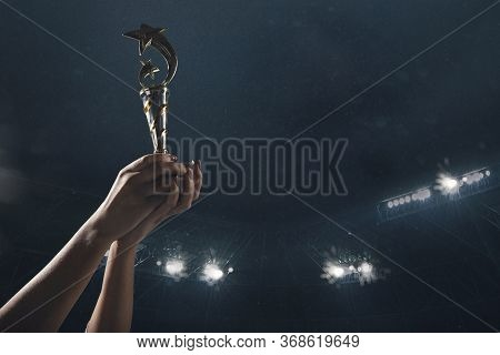 Proud And Strong. Award Of Victory, Male Hands Tightening The Golden Cup Of Winners Against Cloudy D