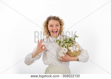 Happy Easter Day. Happy Woman Shows Sign Ok. Okay. Eggs Hunt. Smiling Woman Holds Basket With Eggs A