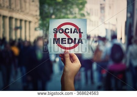 Social Media Censorship, Political War Between Us President Banning Social Networks. Hand Holding A