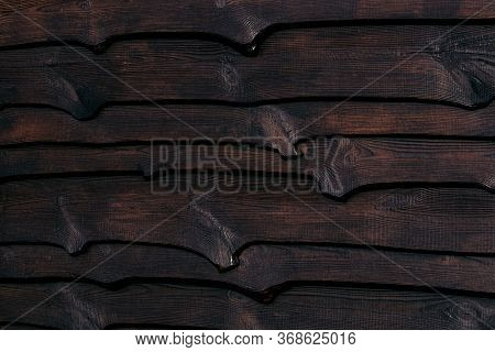 A Fragment Of A Strong Wooden Fence. Horizontal Boards Are Tightly Nailed To Each Other And Provide