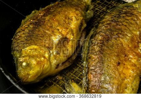 Fried Crucians In A Pan. Cooking Fried Fish. A Dish Of Fried Crucian Carp. Tasty River Fish. Fresh C