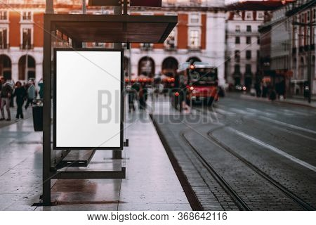 A Blank Advertising Billboard Placeholder Template On The City Street; An Empty Mock-up Of An Outdoo