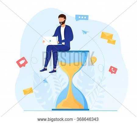 Multitasking Concept. Young Attractive Man Sitting On An Hourglass And Working On A Laptop. Producti