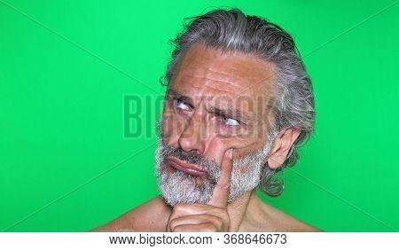 Portrait Of Al Mature Man Assuming The Thinker Pose