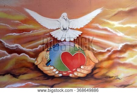 OLD GOA, INDIA - FEBRUARY 18, 2020: Holy Spirit Bird, painting in the Basilica Bom Jesus, Old Goa, Velha Goa, Goa, India