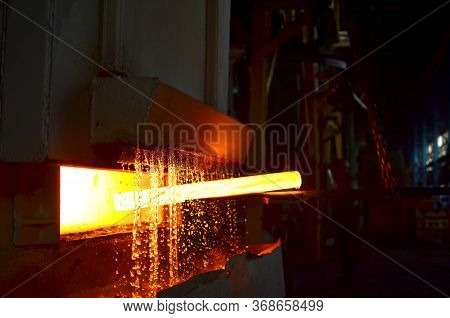 Steel Quenching At High Temperature In Industrial Furnace At The Workshop Of A Forge Plant. Process