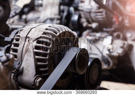 Close-up Of The Generator On An Engine With A Bypass Belt Is A Part In The Form Of A Rubber Ring Beh