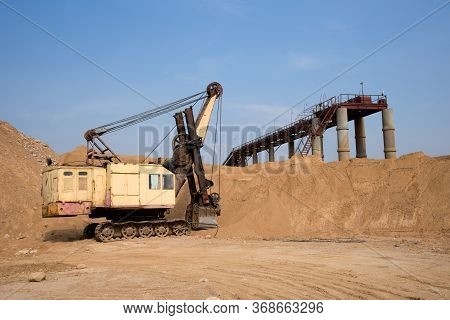 Huge Mining Excavator In The Sand Open-pit. Biggest Digger Working In Quarry. Largest Tracked Machin