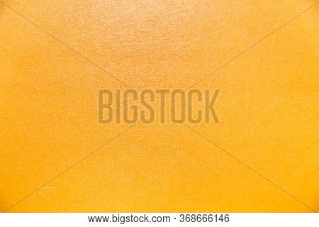 Background Of Extruded Polystyrene Foam Yellow With Smooth Surface, Construction, Texture, Design.