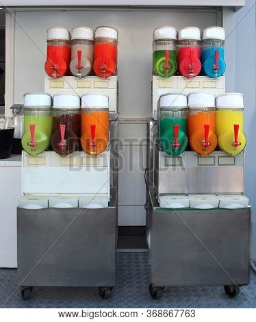 Many Flavors Of Iced Slush With The Dispenser Without People