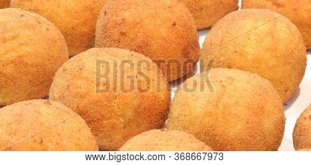 Stuffet Balls Of Rice Called Arancini In Italy For Sale At Street Food Stand