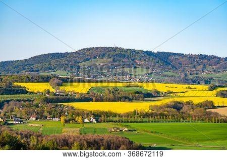 Landscape Of Bohemian Paradise, Czech: Cesky Raj, With Sandstone Rock Formations And Kozakov Mountai