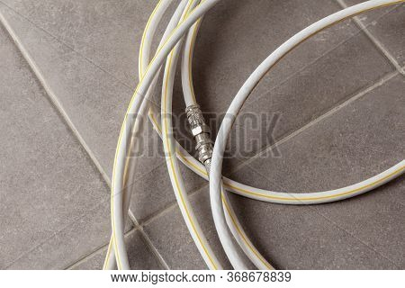 Fiber Optic Wire In The Apartment On The Tiled Floor. Isp Cable With Extension Cord. High Speed Inte