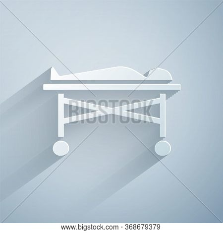 Paper Cut Dead Body In The Morgue Icon Isolated On Grey Background. Paper Art Style. Vector.