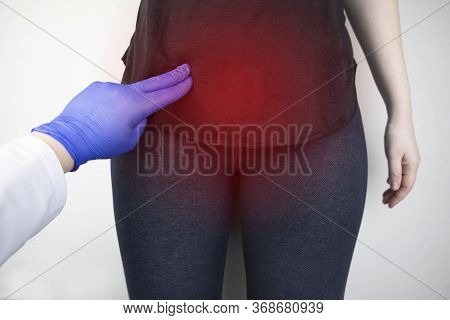 A Woman Suffers From Pain In The Pelvic Organs. The Gynecologist Examines The Patient. Painful Locat