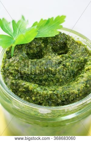 Smile Drawn On Homemade Parsly Pesto With Cashew Nuts In Glass Jar, Decorated With Green Leaves. Mac