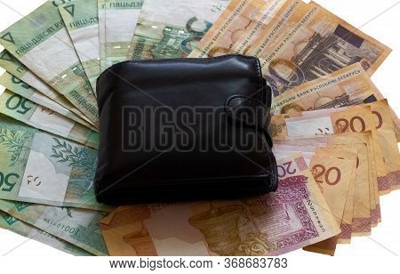 Background Of Belarusian Rubles Banknotes With A Wallet, Texture Of Belarusian Rubles
