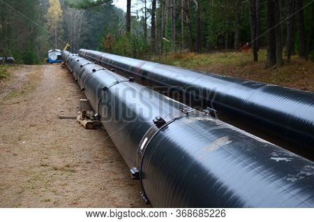 Sections Of Pipe On Top Of Wooden Supports At An Construction Site For Natural Gas. Construction Of