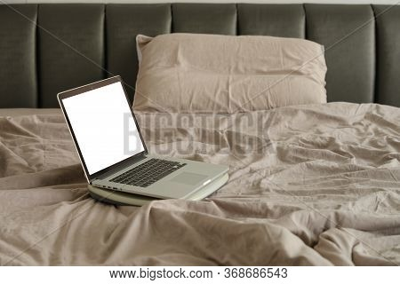 Laptop On Bed. Work At Home Or Working Frome Home Concept.