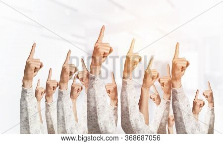 Row Of Man Hands Showing Finger Pointing Gesture With Forefinger. Group Of Human Hands Gesturing On
