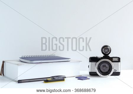 Camera, Photography Tutorial, Memory Card, Pen On A Gray Background, Study Concept