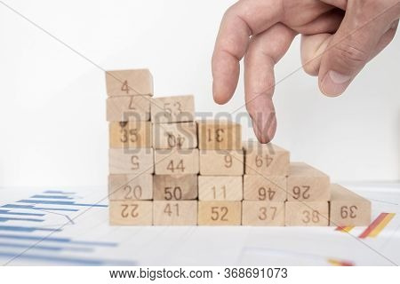 Male Hand Walking His Fingers Up Wooden Steps Stairs On The Way To Success And Aspiration. Charts Do