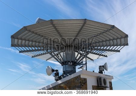 Image Of Lighthouse Reflector Against A Blue Sky Close-up