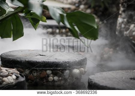Defocused And Blurred Image For Background. Hot Springs, Boiling And Steaming Water In Geyser Vent.