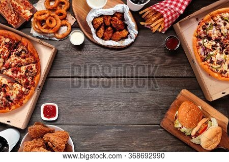 Variety Of Take Out And Fast Foods. Pizza, Hamburgers, Fried Chicken And Sides. Frame. Top View On A