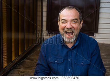 Jubilant joyful country man at his home
